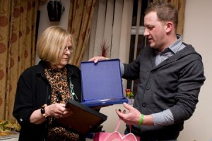 Picture of our Queen of Cakes receiving a plaque and certificate